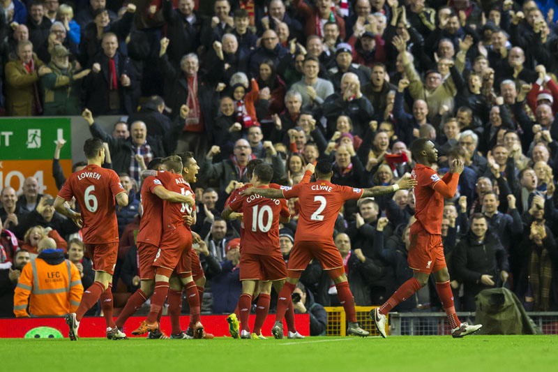 Liverpool's Christian Benteke (right) celebrates with teammates after scoring during the English Premier League soccer match between Liverpool and Leicester City at Anfield Stadium, Liverpool, England, on Saturday, December 26, 2015. Photo: AP