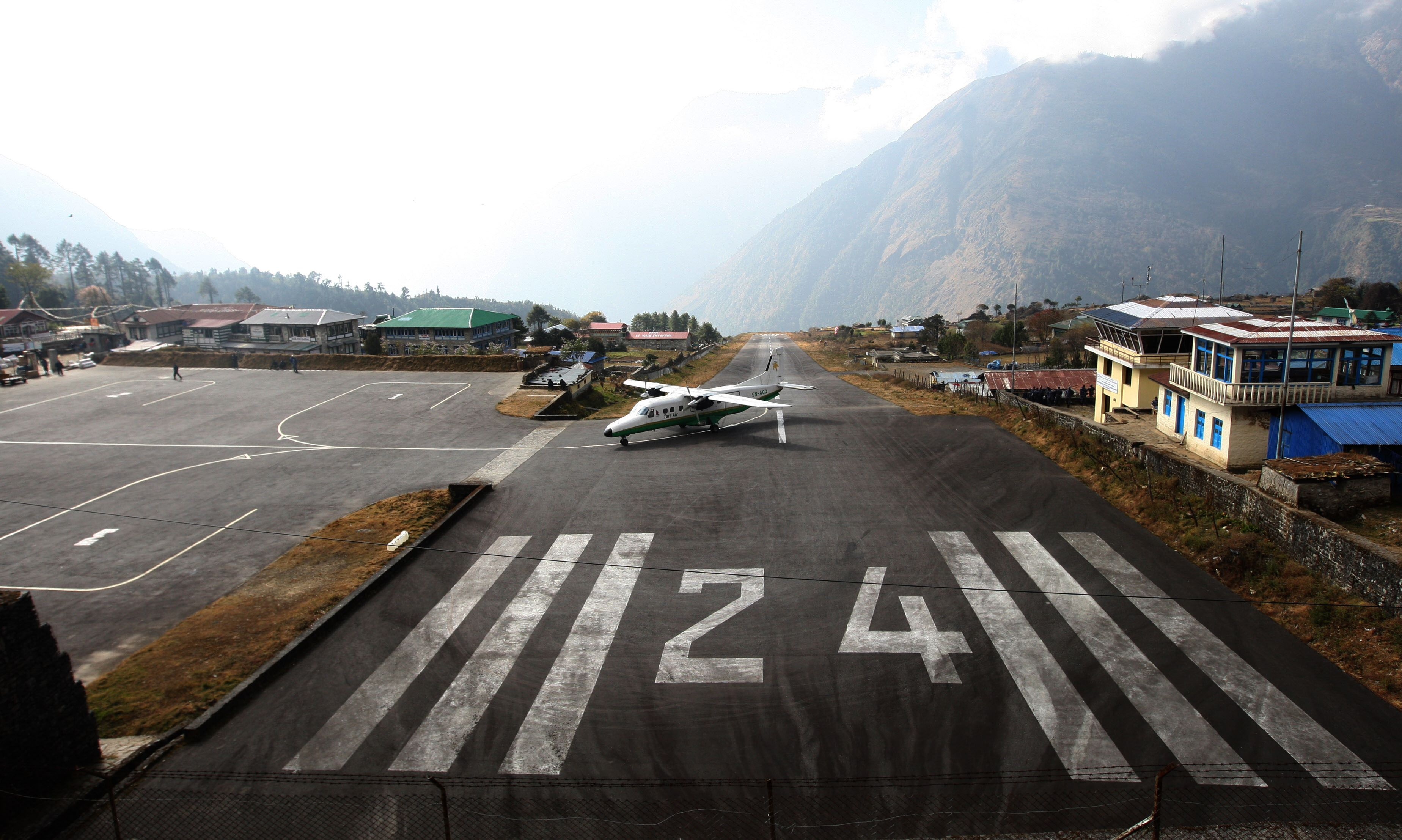 In this photograph taken on December 2, 2009, A Tara Air Dornier Do 228 aircraft taxis after landing at the Tenzing-Hillary Airport in Lukla, some 140 kilometres (87 miles) northeast of Kathmandu. Photo: AFP/ File