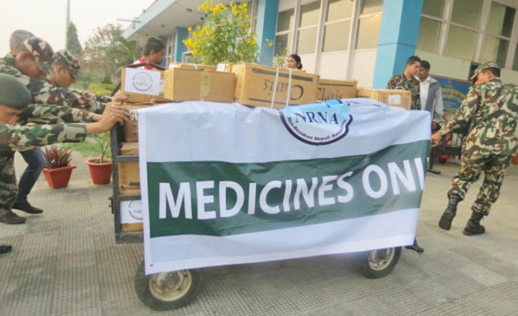 Nepal Army personnel ferrying the medicines chartered by the Non-Resident Nepali Association on a Nepal Army aircraft at the Gautam Buddha Airport in Bhairahawa, for distribution, on December 1. Photo: RSS