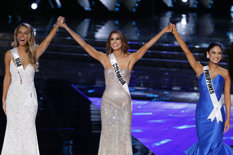 From left, Miss USA Olivia Jordan, Miss Colombia Ariadna Gutierrez and Miss Philippines Pia Alonzo Wurtzbach react as they make the final three at the Miss Universe pageant on Sunday, December 20, 2015, in Las Vegas. Photo: AP