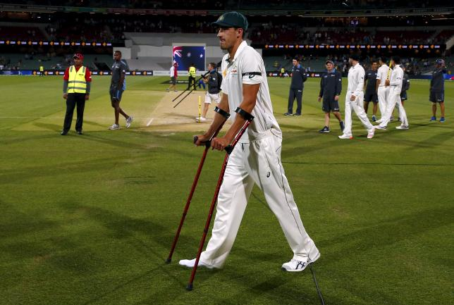 Australia's Mitchell Starc uses crutches as he walks to the presentation ceremony after the third day of the third cricket test match against New Zealand at the Adelaide Oval, in South Australia, November 29, 2015. REUTERS/David Gray