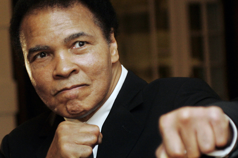 US boxing great Muhammad Ali poses during the Crystal Award ceremony at the World Economic Forum (WEF) in Davos, Switzerland in this January 28, 2006. Photo: Reuters/ File