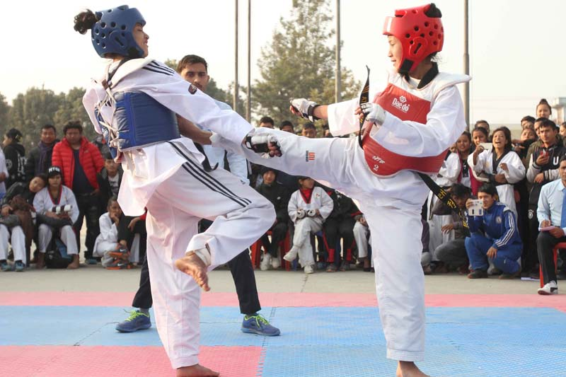 Namrata Tuladhar (right) of Nepal Army Club fights against Sushma Shrestha of Koteshwor in women's senior 57kg final bout during the 7th Korean Ambassador Taekwondo Championship at International Sports Complex in Lalitpur on Tuesday, December 22, 2015. Photo: Udipt Singh Chhetry/ THT