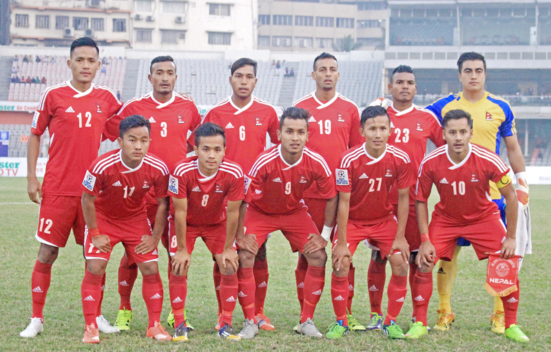 The Nepali national football team pose for a photo before the International friendly match against Bangladesh at  Bangabandhu Stadium on Thursday, December 17, 2015. Courtesy: ANFA