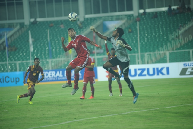 Nepal's goalkeeper Kiran Limbu jumps to punch a ball in the first half of the inaugural match of SAFF Suzuki Cup between Nepal and Sri Lanka at Trivandrum on Wednesday, December 23. Photo: Anil Ghimire/THT