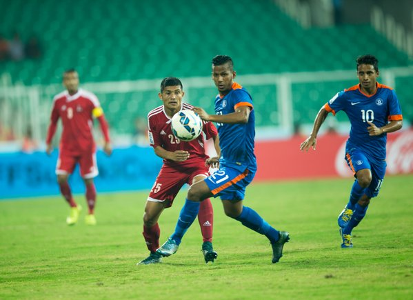 Players vie for ball at the match between Nepal and India. Photo: SAFF