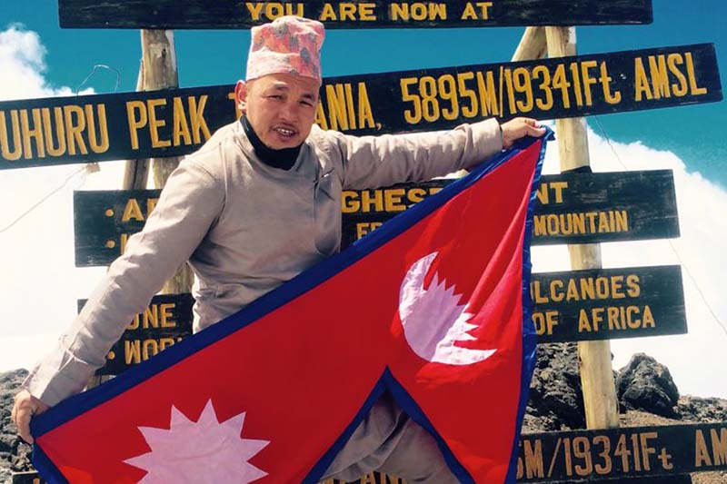 Nepali mountaineer and athlete Sanjay Pandit posing for a photo at the summit of Mount Kilimanjaro, highest peak of Africa, on Monday, December 21, 2015. He has made another record by climbing the peak backwards in 24 hours 40 minutes. Photo: RSS