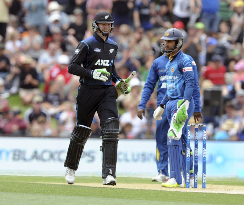 New Zealandu0092s Martin Guptill all smiles runs pass Sri Lankau0092s Dinesh Chandimal after hitting the winning runs, 93 not out against Sri Lanka in the second One Day International Cricket match at Hagley Park Oval in Christchurch, New Zealand, on Monday, December 28, 2015. Photo: AP