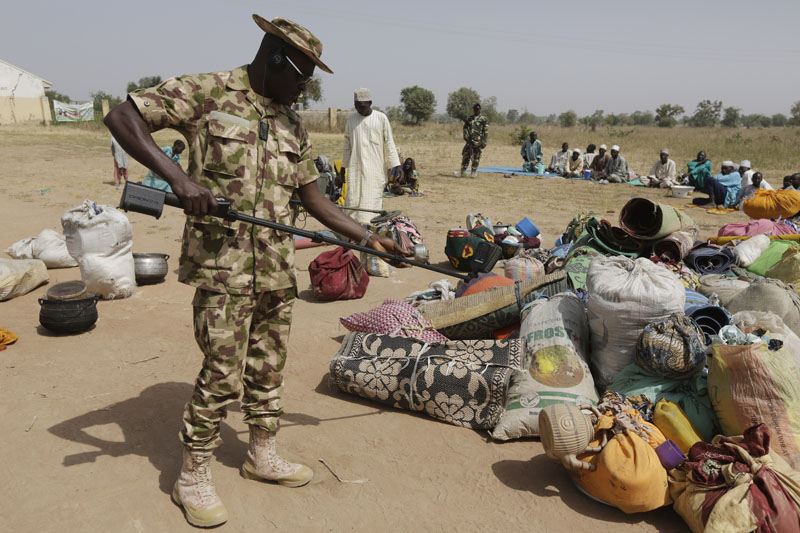 Soldiers screen newly arrived displaced people at Furore camp in Yola, Nigeria on Tuesday, December 8, 2015. Photo: AP