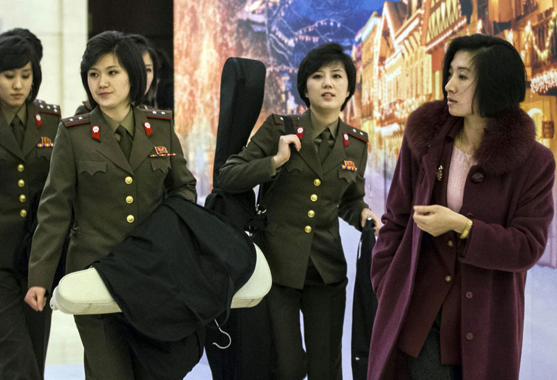 Members of the Moranbong Band and the State Merited Chorus of North Korea arrived at a hotel in Beijing, China on Thursday, December 10, 2015. The Moranbong, an all-female band formed by Kim Jong Un were scheduled to perform behind closed doors in Beijing on a visit to cultivate better ties with China. Photo: AP