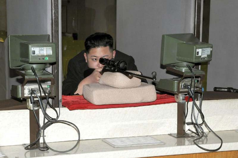 North Korean leader Kim Jong-un aims a gun during an inspection tour of the Sporting Bullet Factory in Pyongyang. Photo: AFP/ File