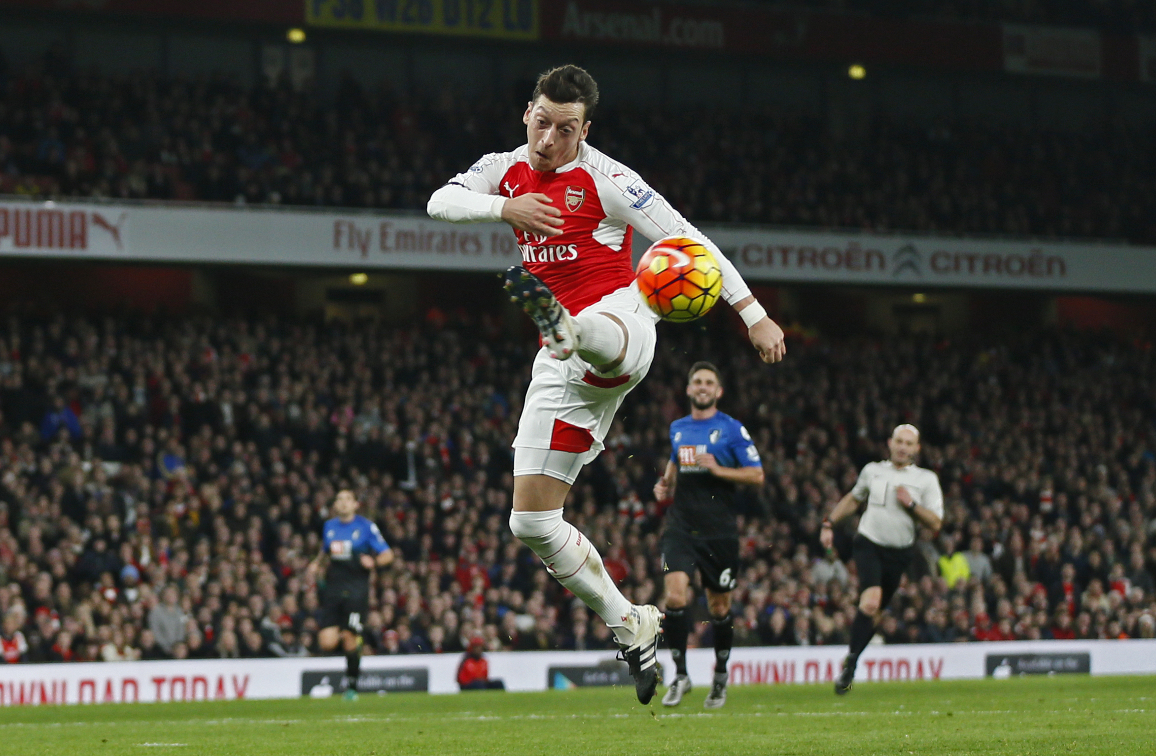 Arsenalu2019s Mesut Ozil controls the ball during their English Premier League match againstnBournemouth at the Emirates Stadium in London on Monday. Arsenal won the match 2-0.