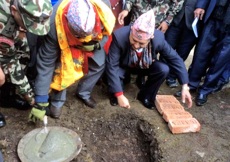 Prime Minister KP Sharma Oli laying the foundation stone of a drinking water and sanitation project for the quake survivors in Barpak of Gorkha on Thursday, December 17, 2015. Photo: PM's twitter account