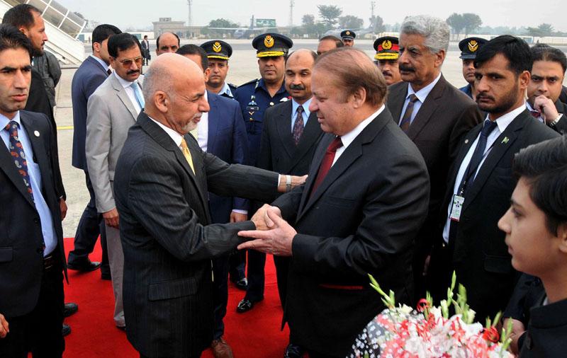 Pakistani Prime Minister Nawaz Sharif (center right) greets Afghan President Ashraf Ghani (center left) upon his arrival at Nur Khan airbase in Rawalpindi, Pakistan on Wednesday, December 9, 2015. Photo: AP