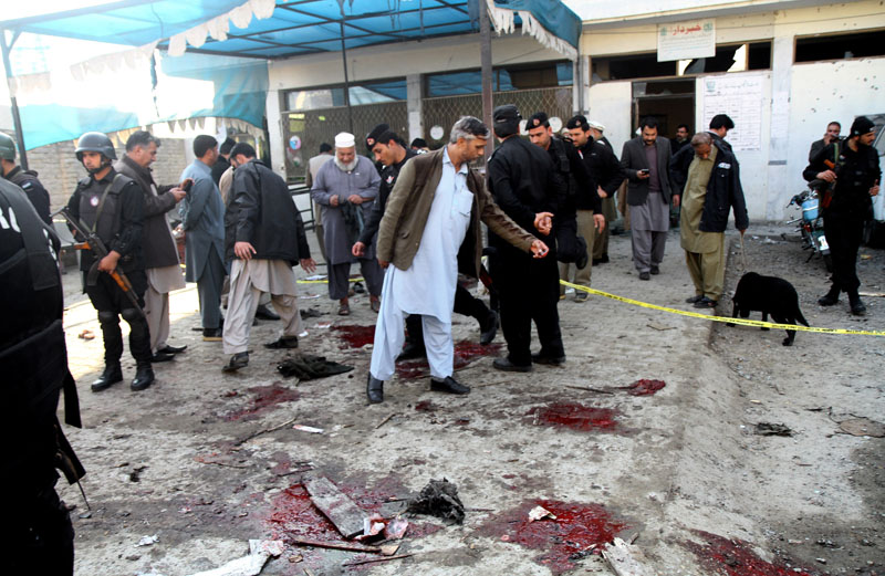 Pakistani security officials examine the site of a suicide attack in Mardan, Pakistan, on Tuesday, December 29, 2015. Photo: AP