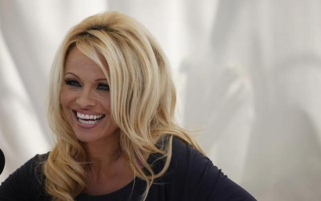 Actress Pamela Anderson answers a question at a news conference to announce the launch of the online social platform FrogAds.com, in West Hollywood, California March 22, 2012.   REUTERS/Mario Anzuoni/Files
