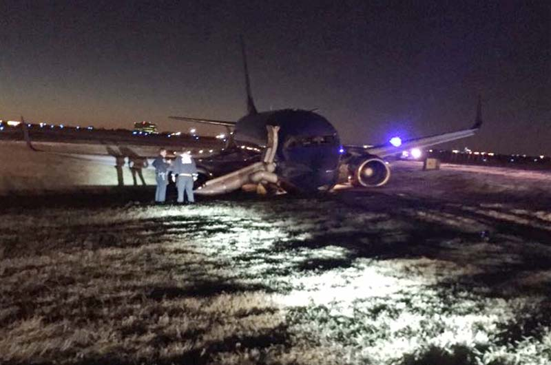 Emergency personnel standby a Southwest Airlines plane that rest on the ground after skidding off the runway at Nashville International Airport, Tuesday, December 15, 2015, in Nashville, Tennesse. Photo: Carson O'Shoney via AP