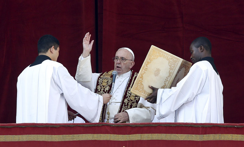Pope Francis makes a blessing during the u201cUrbi et Orbiu201d (to the City and the World) message on Christmas Day from the balcony overlooking St Peteru2019s Square at the Vatican, on Friday. Photo: Reuters