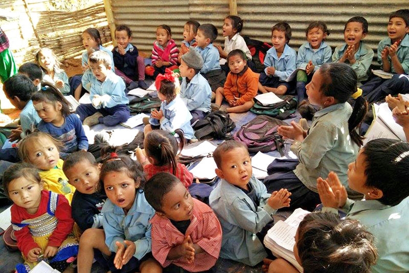 Quake-affected children of BP Memorial Primary School from class 1 to 3 compelled to study under a same roof of a temporary shelter in Taru-4, Nuwakot, on Sunday, December 6, 2015. Photo: RSS