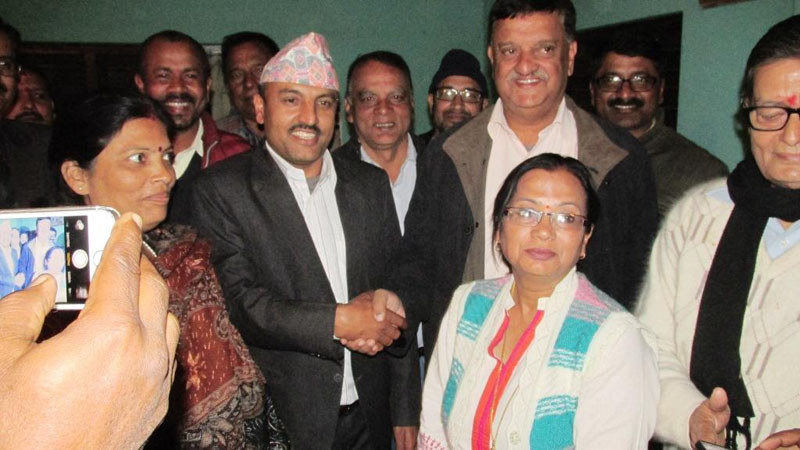 Chief District Officer of Saptari district, Narayan Bhatta and representatives of doctors and health professionals posing after signing an agreement in Rajbiraj of Saptari district on Thursday, December 17, 2015. Photo: THT Online