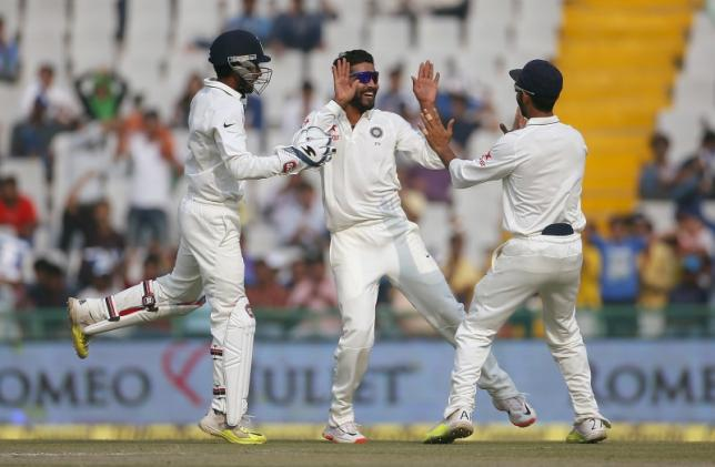 File photo of India's Ravindra Jadeja (C), wicketkeeper Wriddhiman Saha and Ajinkya Rahane (R) celebrating the dismissal of South Africa's Dane Vilas (not pictured) during the third day of their first cricket test match, in Mohali, India, November 7, 2015. REUTERS/Adnan Abidi