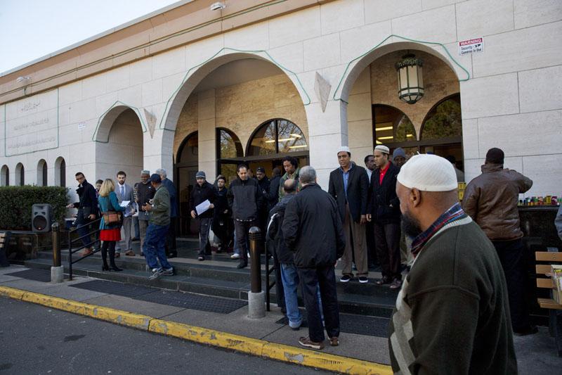 people arrive for Friday prayers at Dar al-Hijrah Mosque in Falls Church, Va on  December 4, 2015. Photo: AP