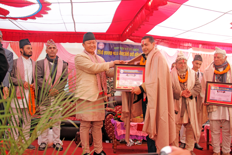 Minister for Information and Communication Sher Dhan Rai felicitate The Himalayan Times journalist Rishi Ram Baral in Pokhara on Monday, December 21, 2015. Photo: THT