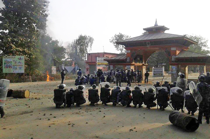 Police taking defensive position after clash with UDMF cadres at Jamunnaha Border, in Banke, on Wednesday, December 02, 2015. Photo: THT