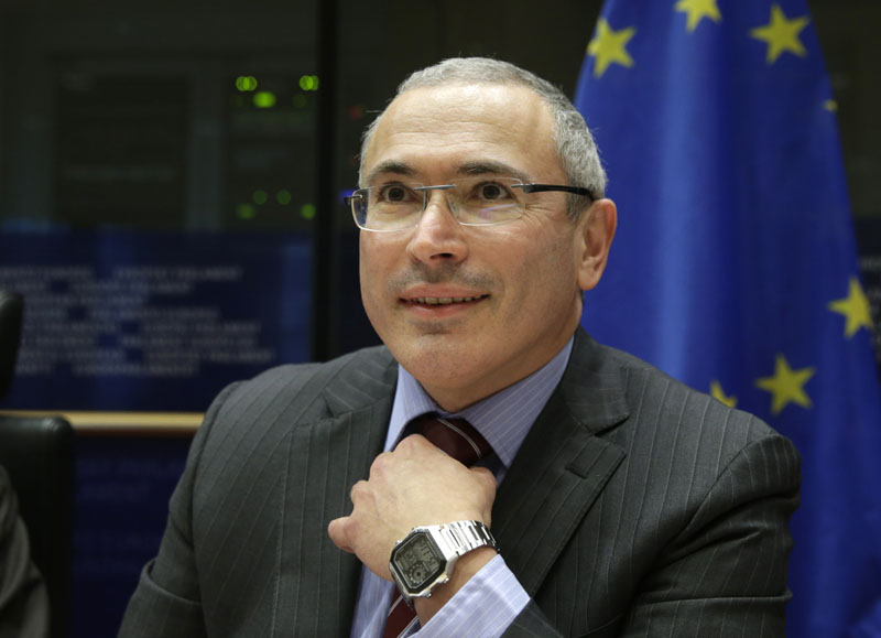 Russian businessman and Amnesty International prisoner of conscience Mikhail Khodorkovsky smiles as he attends the Foreign Affairs Committee for a debate on human rights situation in Russia at the European Parliament building, in Brussels, Belgium on December  2, 2014. Russia's former richest man Khodorkovsky, who spent 10 years in prison before he was pardoned and left Russia in 2013, says he has been summoned for questioning in Moscow on Tuesday, December 8, 2015. Photo: AP