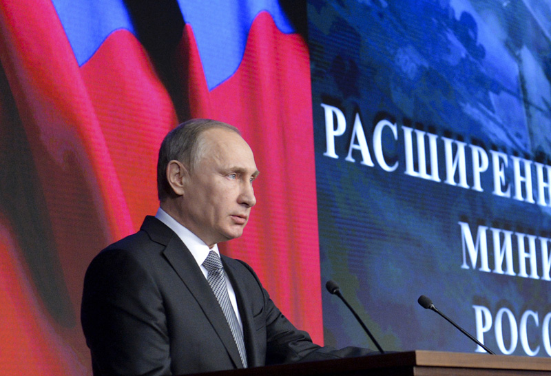 Russian President Vladimir Putin delivers his speech during a meeting with top military officials in Moscow, Russia, Friday, Dec. 11, 2015. Putin said the Russian military action helped change the situation in Syria, supporting the Syrian army offensive. Photo: AP