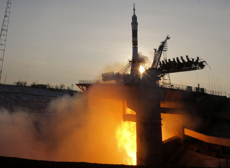 The Soyuz-FG rocket booster with Soyuz TMA-19M space ship carrying a new crew to the International Space Station, ISS, blasts off at the Russian leased Baikonur cosmodrome, Kazakhstan on Tuesday, December 15, 2015. Photo: AP