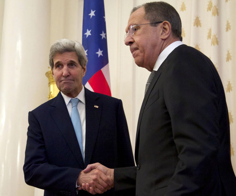 US Secretary of State John Kerry (left) shakes hands with Russian Foreign Minister Sergey Lavrov in Moscow on Tuesday, December 15, 2015. Photo: AP