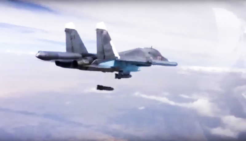 FILE - Photo made from video footage provided by the Russian Defense Ministry, a Russian Su-34 bomber drops bombs on a target on December 9, 2015. Photo: AP