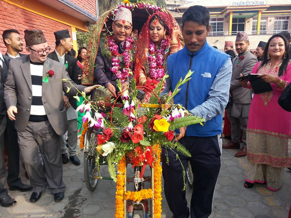 Sailendra Dangol and his wife, Sumira Shrestha, ride a rickshaw after their marriage in Kathmandu on Thursday, December 16, 2015. Courtesy: Cycle City Network Nepal