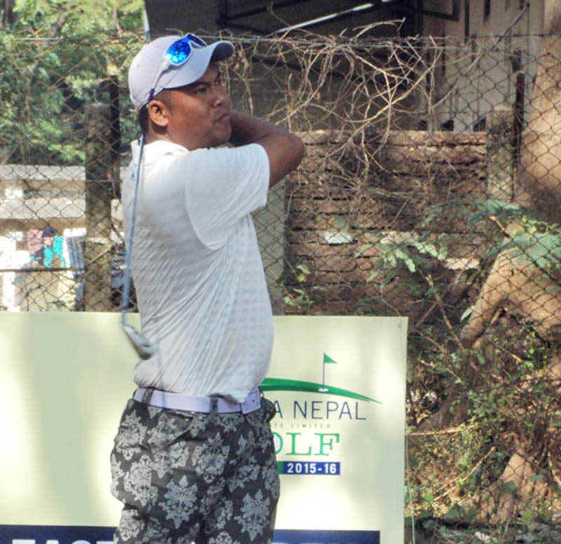 Sanjay Lama watches the ball after hitting a shot during the first round of the Surya Nepal nEastern Open at the Nirvana Country Club in Dharan on Wednesday. Photo Courtesy: Nepal PGA