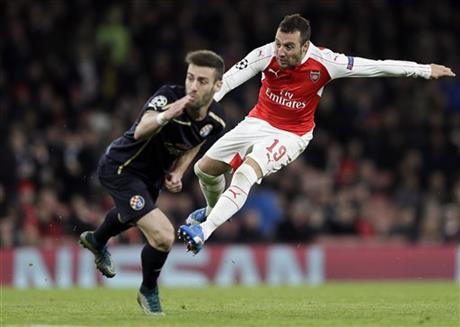 Arsenal's Santi Cazorla, right, is challenged by Zagreb's Ivo Pinto during the Champions League Group F soccer match between Arsenal and Dinamo Zagreb, at The Emirates Stadium in London, Britain, Tuesday, Nov. 24, 2015. AP