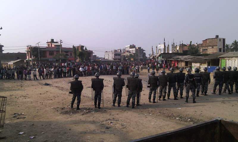 Security personnel stand guard at BP Chok of Gaur as protesters defy curfew and take to street on Tuesday, December 22, 2015. Photo: Prabhat Kumar Jha
