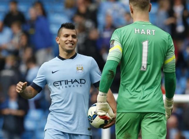 Manchester City's Sergio Aguero celebrates with goalkeeper Joe Hart after their English Premier League soccer match against Tottenham Hotspur at the Etihad Stadium in Manchester, northern England October 18, 2014. REUTERS/Phil Noble/files