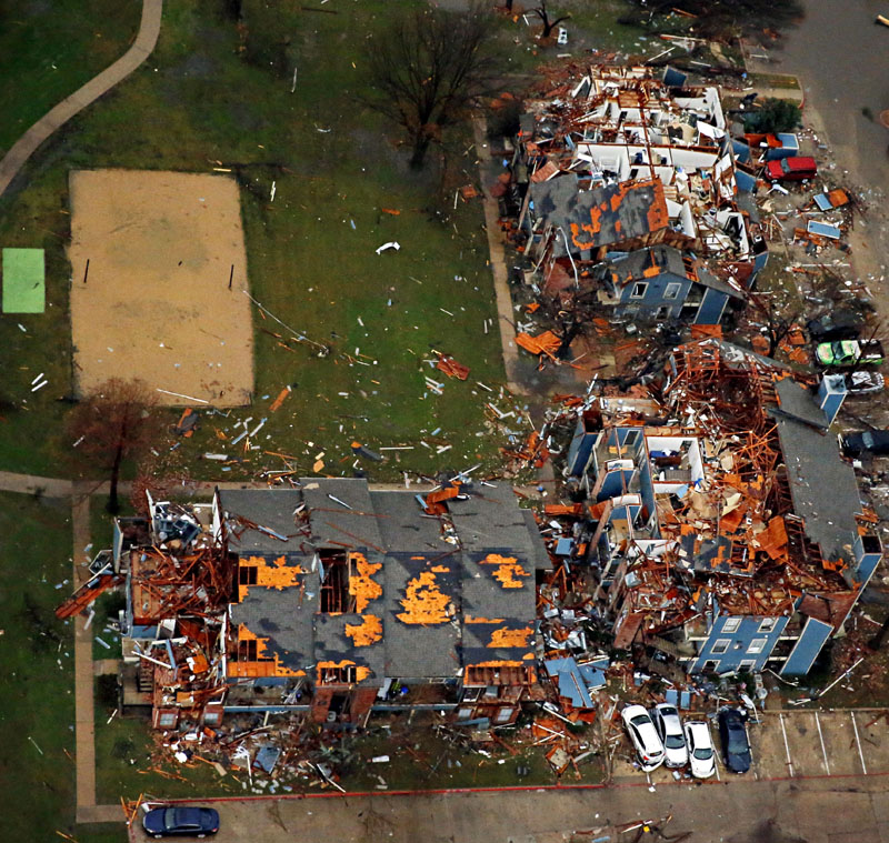 Damage to an apartment complex is seen after Saturday's tornado in Garland, Texas, on Sunday, December 27, 2015. Photo: AP