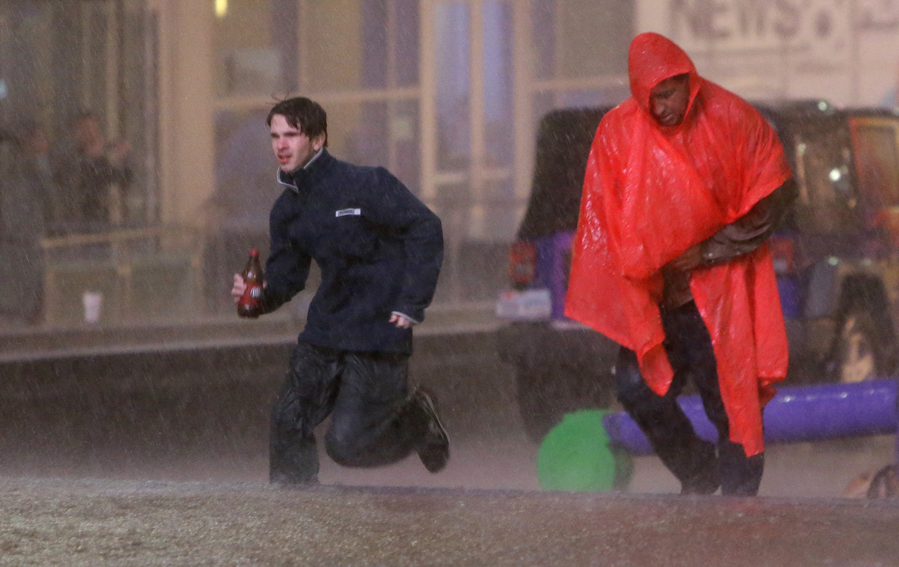 People run as weather sirens sound as a severe storm passes over downtown Dallas, Saturday, December 26, 2015. Photo: AP