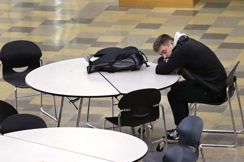 A student leans on a table in the cafeteria during first period at Roosevelt High School in Seattle on November 23, 2015. Photo: AP/ File