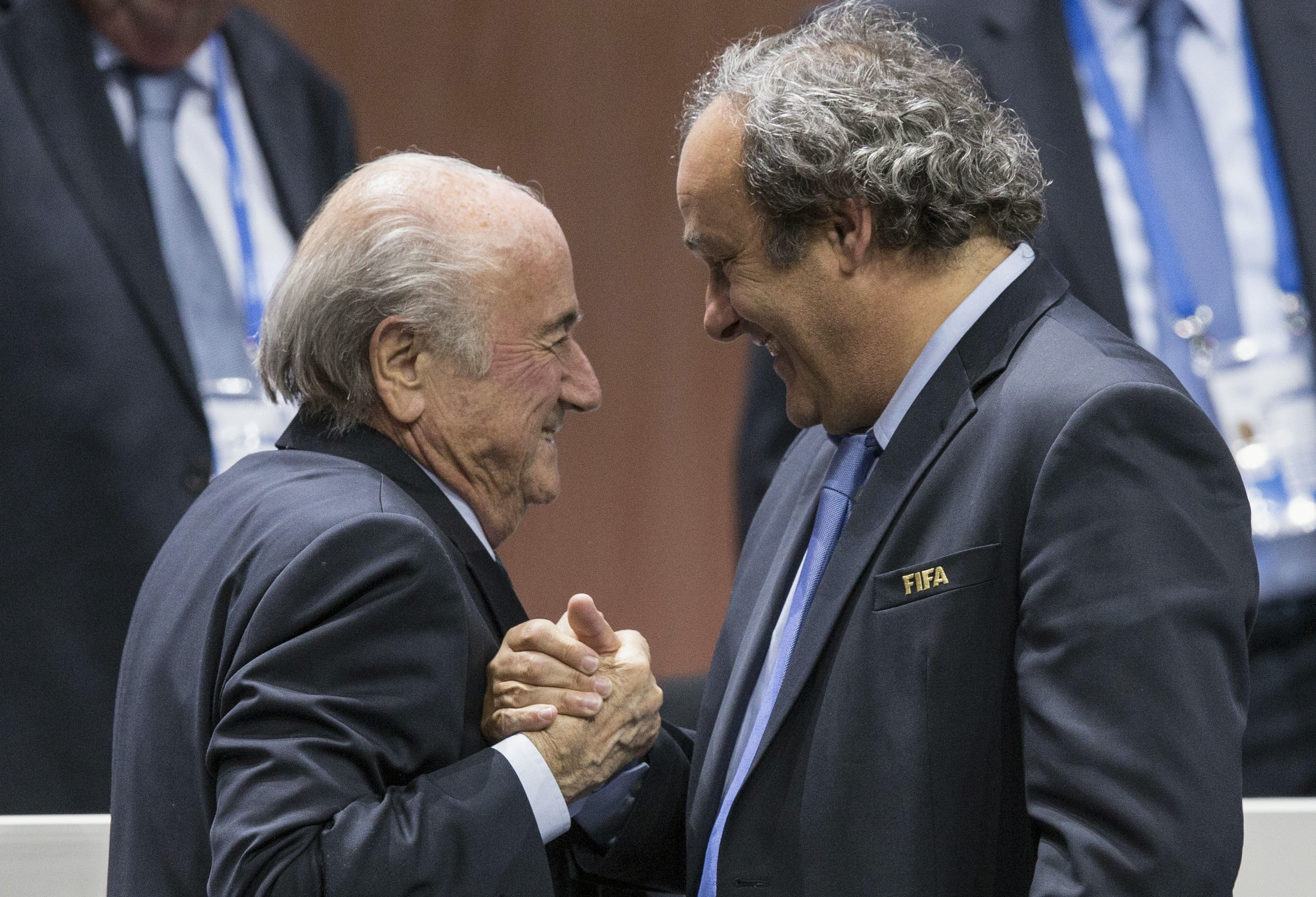 FILE - In this Friday, May 29, 2015 file photo, FIFA president Sepp Blatter after his election as President, left, is greeted by UEFA President Michel Platini, right, at the Hallenstadion in Zurich, Switzerland. Photo: Reuters