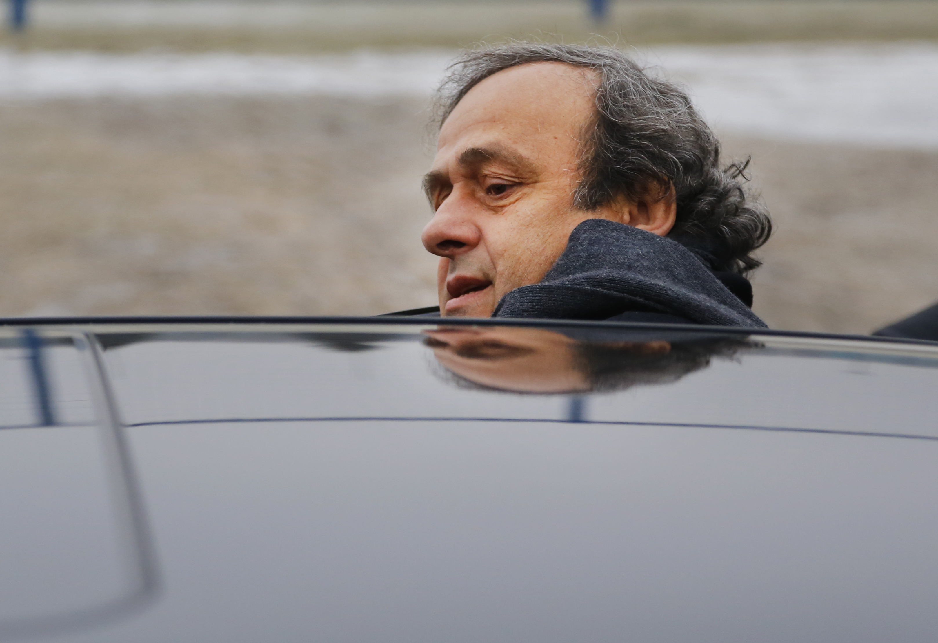 FILE - In this Jan. 19, 2015 file photo UEFA President Michel Platini gets into a car after a visit to the football arena in Minsk, Belarus. Photo: AP