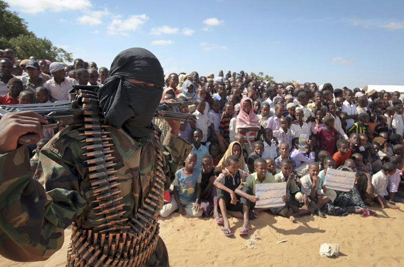 An armed member of the militant group al-Shabab attends a rally in support of the merger of the Somali militant group al-Shabab with al-Qaida, on the outskirts of Mogadishu, Somalia on Monday, February 13, 2012. Photo: AP