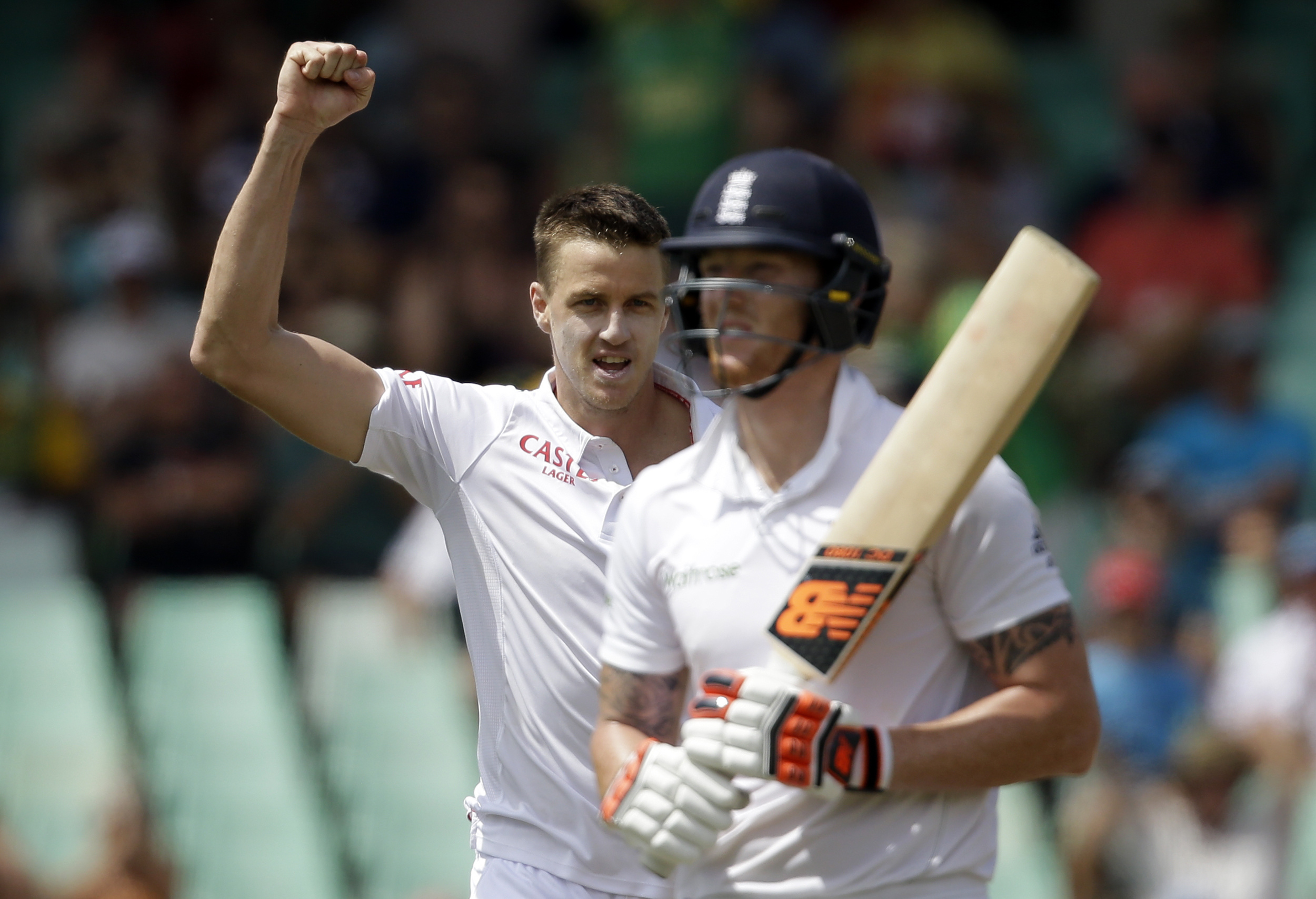 South Africau0092s bowler Morne Morkel, left, clenches his fist after dismissing Englandu0092s batsman Ben Stokes, right, for 21 runs on the second day of their first cricket test match at Kingsmead in Durban, South Africa, Sunday, December 27, 2015. Photo: AP