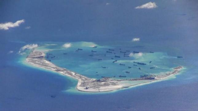 Chinese dredging vessels are purportedly seen in the waters around Mischief Reef in the disputed Spratly Islands in this still image from video taken by a P-8A Poseidon surveillance aircraft provided by the United States Navy May 21, 2015. REUTERS/U.S. Navy/Handout via Reuters/FilesnnATTENTION EDITORS - THIS PICTURE WAS PROVIDED BY A THIRD PARTY. REUTERS IS UNABLE TO INDEPENDENTLY VERIFY THE AUTHENTICITY, CONTENT, LOCATION OR DATE OF THIS IMAGE. THIS PICTURE IS DISTRIBUTED EXACTLY AS RECEIVED BY REUTERS, AS A SERVICE TO CLIENTS. EDITORIAL USE ONLY. NOT FOR SALE FOR MARKETING OR ADVERTISING CAMPAIGNS