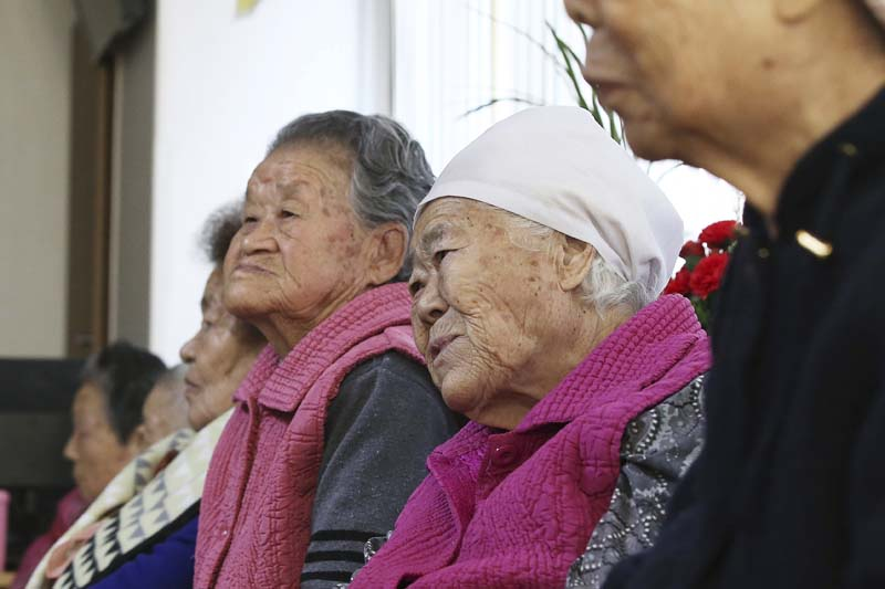 Former South Korean sex slaves, who were forced to serve for the Japanese Army during World War II, wait for results of a meeting of South Korean and Japanese foreign ministers at the Nanumui Jip, The House of Sharing, in Gwangju, South Korea, on Monday, December 28, 2015. Photo: Yonhap via AP