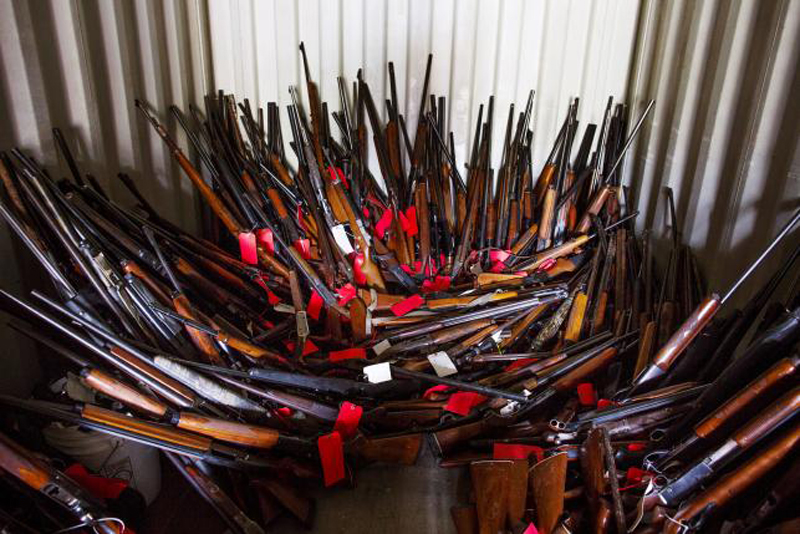 Stacks of guns belonging to Brent Nicholson, seen in a police shipping corner, in Pageland, South Carolina, November 10, 2015. Photo: Reuters