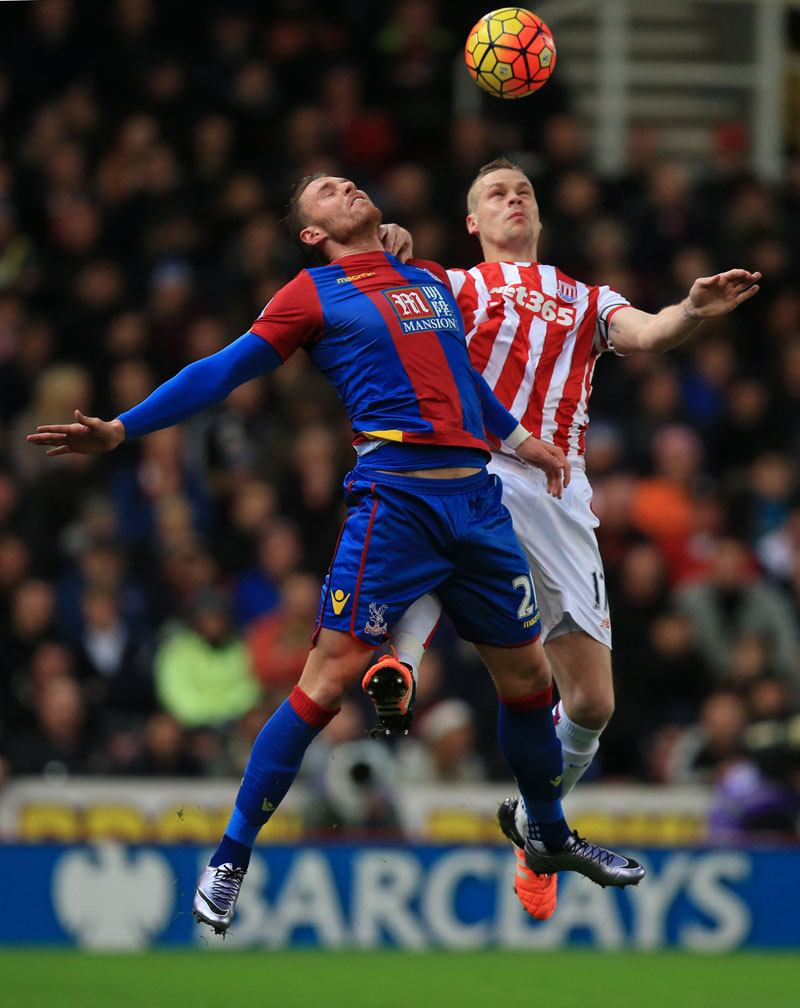 Stoke City's Ryan Shawcross, right, and Crystal Palace's Connor Wickham in action during the English Premier League soccer match at the Britannia Stadium, Stoke, England on Saturday December 19, 2015. Photo: AP