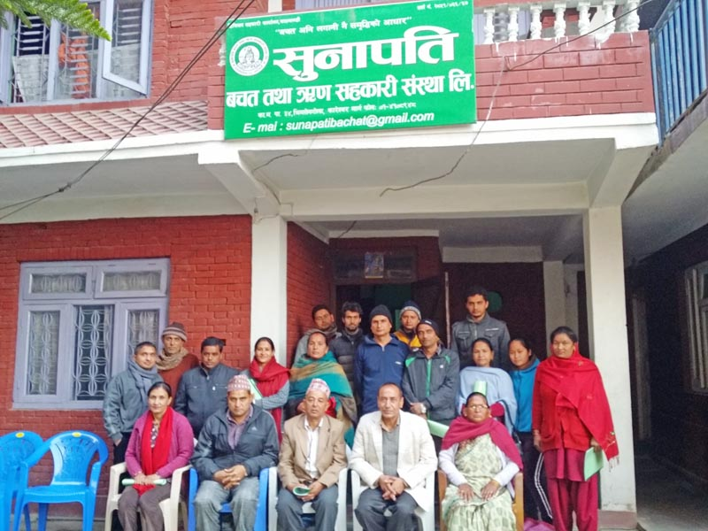 Members of Sunapati Saving and Credit Cooperative posing for a photo after the completion of sixth general assembly meeting, located in Bhimsengola of New Baneshwor of Kathmandu-34, on Saturday, December, 2015. Photo: Courtesy Dipak Khadka